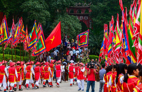procession of people in costumes phu tho vietnam