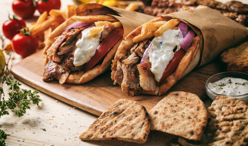 two gyros on plate with mezes greece