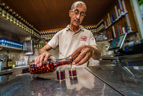 Man pouring ginja liquer Portugal