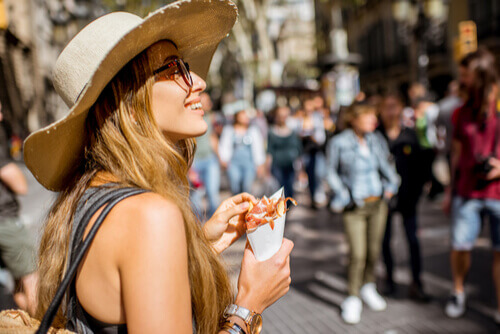 Girl with cone of jamon in Spain