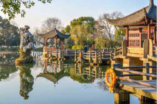 west lake hangzhou with traditional buildings china