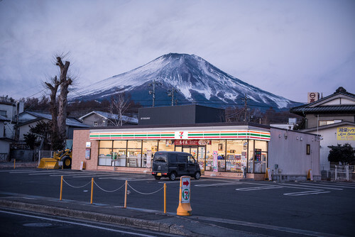 7-eleven store in front of mt fuji japan